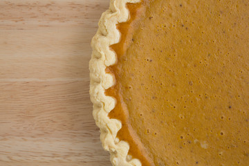 Close view of a pumpkin pie on a table