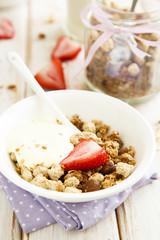 Homemade granola with saffron yogurt