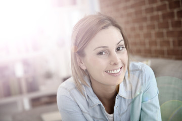 Portrait of charming young woman at home