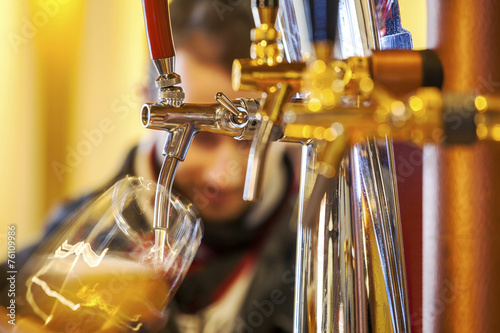 Fotobehang Bier Pouring beer to a glass