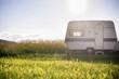 Caravan trailer on rural sunny setting - 76110105