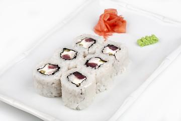 Sushi roll with tuna and salmon.