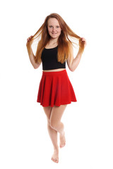 playful young woman in mini skirt