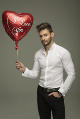 Handsome man with balloon heart