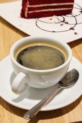 A cup of black coffee on the wood table