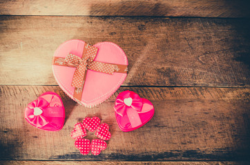 heart gift box on wooden background.