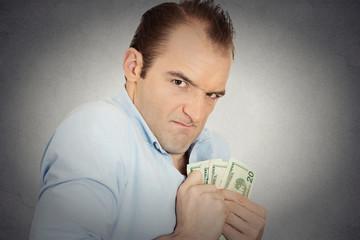 greedy banker executive CEO boss, holding dollar banknotes