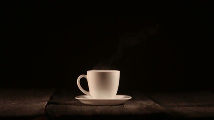 Cup on dark background with smoke