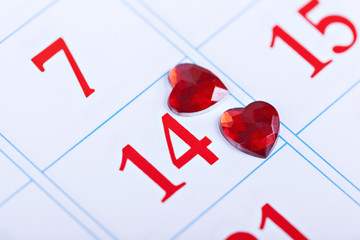 page calendar with two red hearts on Valentine's Day