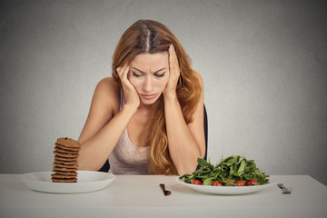 woman tired of diet restrictions deciding to eat healthy food