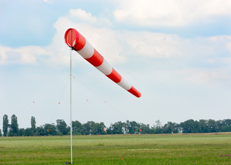 Windsock against cloudy sky.