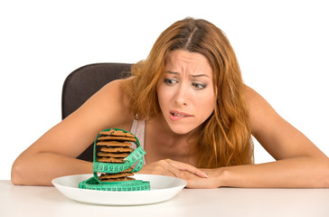woman craving sugar sweet cookies worried about weight gain