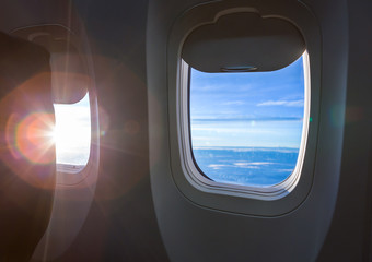 Plane window with cloud view