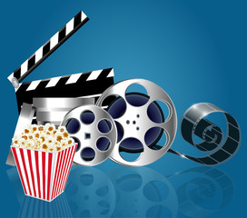 background with popcorn and film strip with reflection