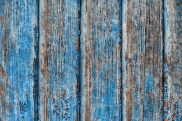 Old ragged blue painted wooden background