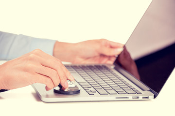 woman hands listening computer stethoscope white background