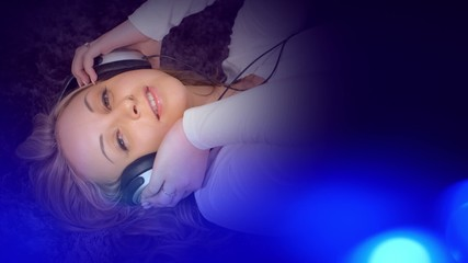 Pretty young woman in headphones listening to music background