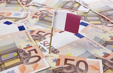 Flag of Malta sticking in 50 Euro banknotes.(series)