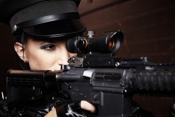 Dark military woman pointing on target