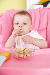 Baby eating in the high chair