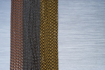 chains on brushed metal background texture