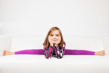 Cute little girl making splits
