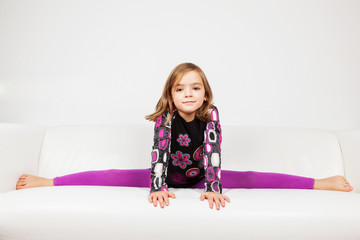 Cute little girl making splits