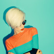 Fashion blond Model with trendy Hairstyle on bllue background. A