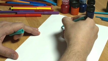 Man draws with a pencil
