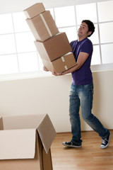Man Carrying Stacked Boxes