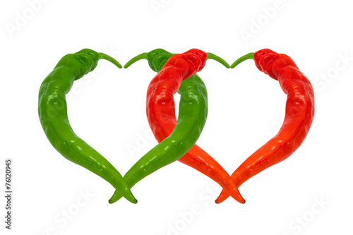 Red and green chili peppers in love - 76120945