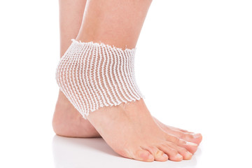 Elastic bandage on the ankle. Sprain.