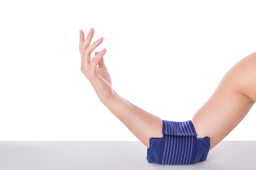 Girl with an elbow injury, ice-cooled gel. Sports injuries.