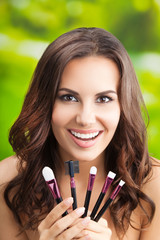 Young woman with make up tools, outdoor