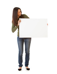Smiling Woman Looks Over At Blank Poster Board