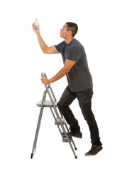 Man Climbs Stepladder To Replace Light Bulb
