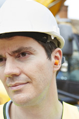 Construction Worker Wearing Protective Ear Plugs