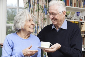 Senior Man Bringing Wife Cup Of Tea