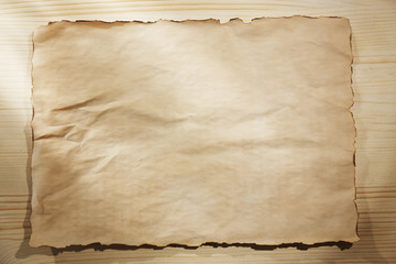 Empty shirt on wooden background, close up