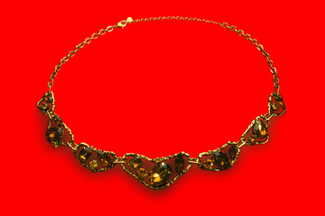 necklace with stones on a red background