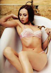 sexy lingerie woman posing in  bath