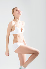 young athletic girl in white lingerie