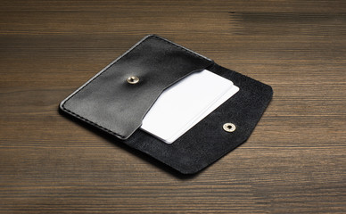 Leather visiting card holder stationary briefcase on wood