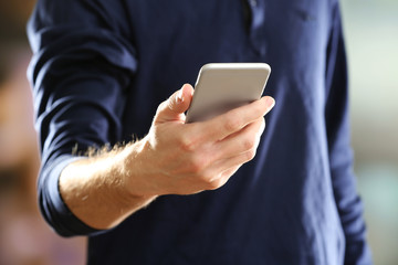 Man using mobile smart phone on bright background
