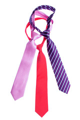 tied men's ties on a white background