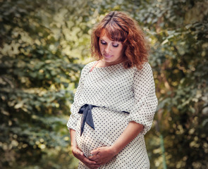 Pregnant woman outdoor portrait