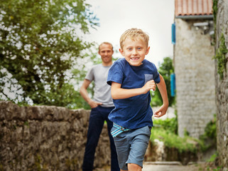 Running little boy portrait