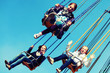 Teen girls on the chain swing carousel
