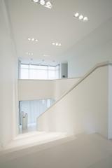 Pure, white stairway inside elegant interior