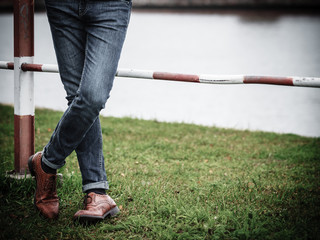 Male legs in jeans and boots